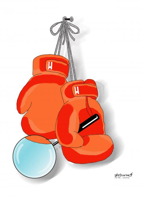 Punching bags with a magnifying glass in their fists are hung on a nail.
